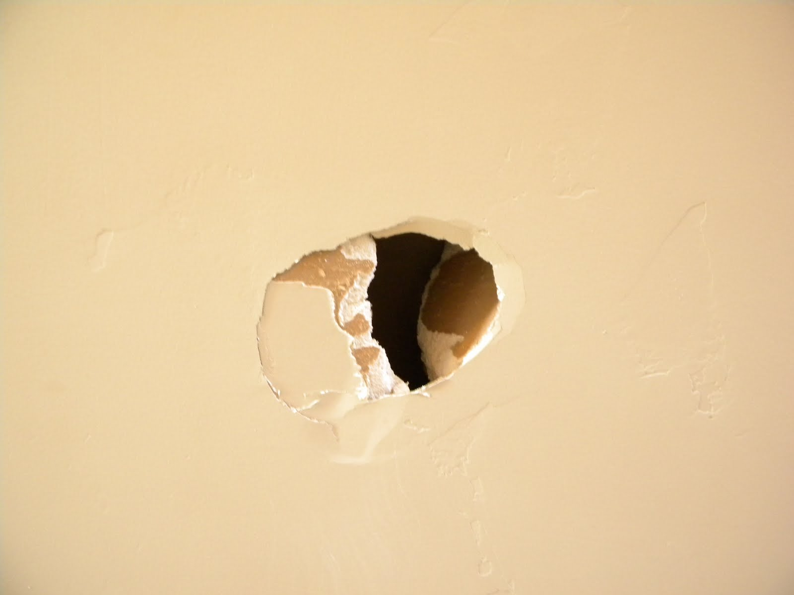 how to fix a punched hole in drywall